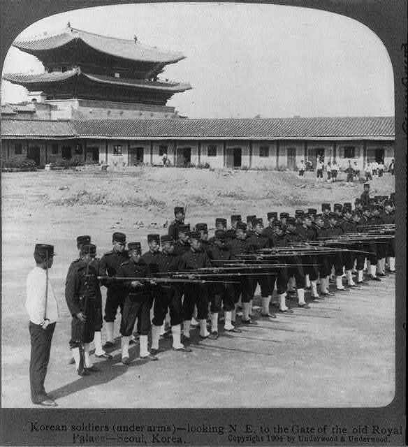 Korean soldiers (under arms) [training with fixed bayonets] - looking N.E. to the gate of the old Royal Palace, Seoul, Korea