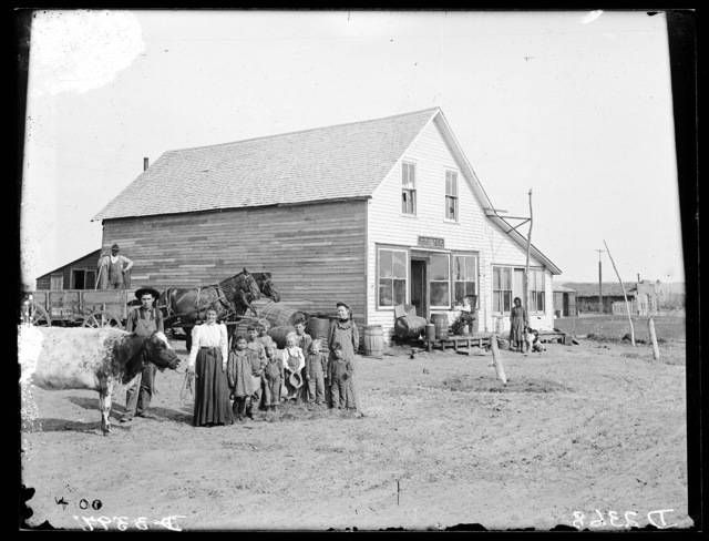 Large group in front of Mr. Sargent's store at Walworth, Custer County, Nebraska