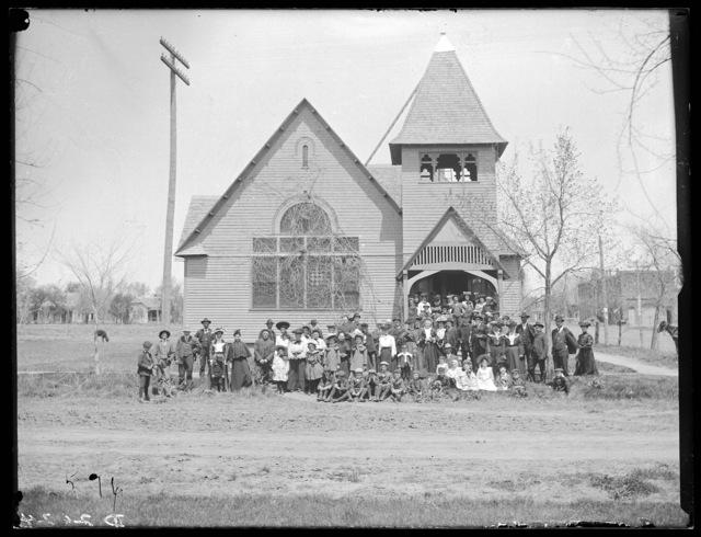 Large group in front of the old Catholic Church, Kearney, Nebraska.