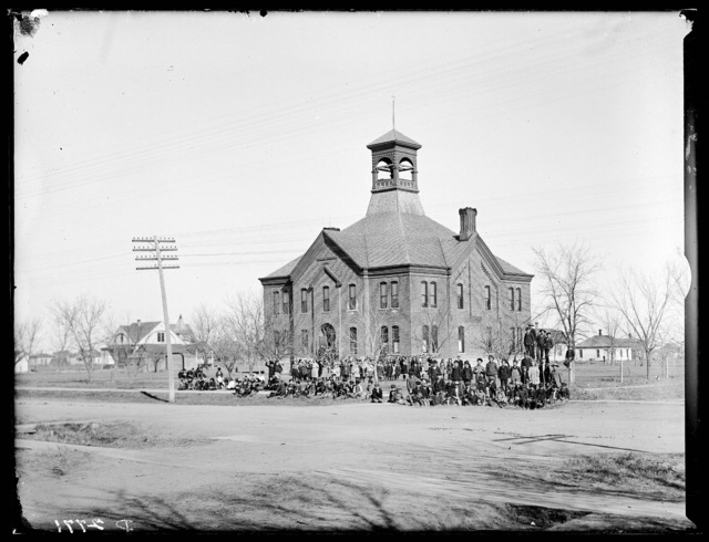 Large group of students in front of Cozad High School, Cozad, Nebraska.