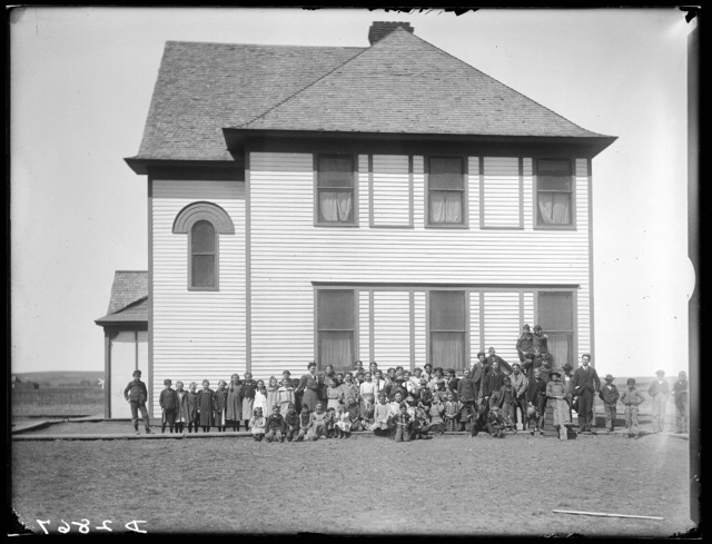 Large group of summer school students and teachers in front of the State Normal School, Kearney, Nebraska