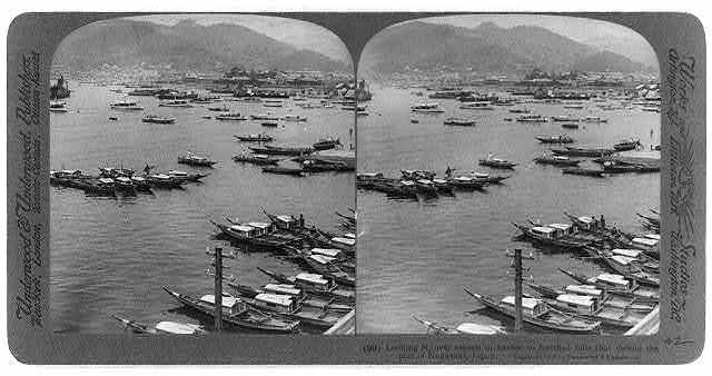 Looking N. over vessels in harbor to fortified hills that defend the port of Nagasaki, Japan