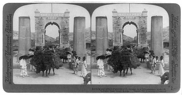 Looking past pillars of ancient arch, through new Independence Arch - N. to Pekin Pass, Seoul