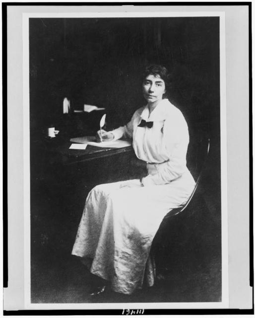 [Madeline Breckinridge, full-length portrait, seated at desk, facing slightly left, with quill pen in hand]
