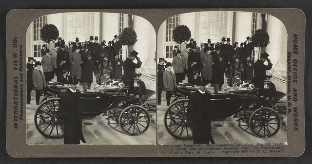 President, Mrs. Roosevelt and Pres. Francis leaving West Pavilion, secret service man in the foreground, World's Fair, St. Louis