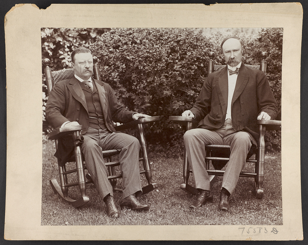 [President Theodore Roosevelt and Senator Charles Fairbanks, seated in rocking chairs on a lawn at Sagamore Hill, Oyster Bay, N.Y.]