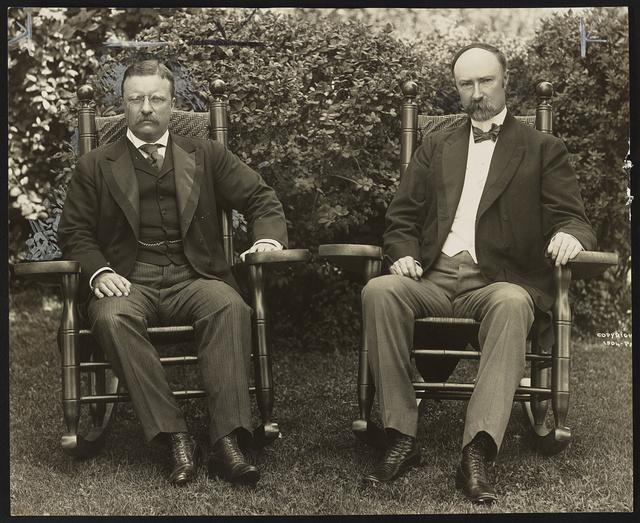 [President Theodore Roosevelt and Vice President Charles Fairbanks, seated in rocking chairs, facing front, on lawn at Sagamore Hill, Oyster Bay, N.Y.]
