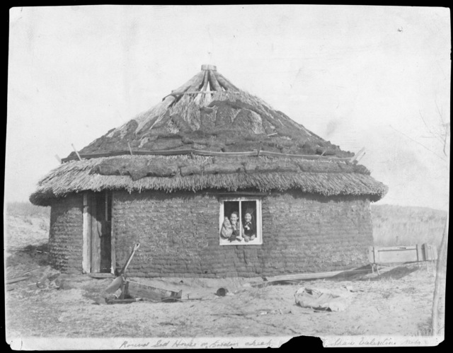 Shaw's unusual round sod house with thatched roof in Cherry County, Nebraska on Gordon Creek.