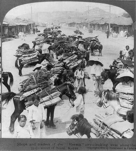 """Shops and traders of the """"Hermit"""" city - looking west along the wide main street of Seoul, Korea"""