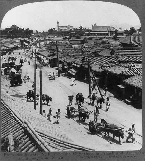 South Gate, N.E. over the city, showing French and American Churches, Seoul, Korea