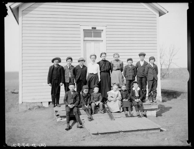 Students and teacher Dave Hill in front of a school west of Watson's Ranch near Kearney in Buffalo County, Nebraska.