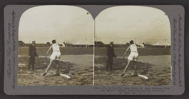 The 18 -year-old giant, Ralph W. Rose, breaking shot-put record, stadium, Louisiana Purchase Exposition, St. Louis, Mo., U. S. A.