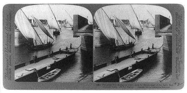 The great Nile Bridge at Cairo open for the passage of the daily fleet of cargo boats--(N.E.) Egypt
