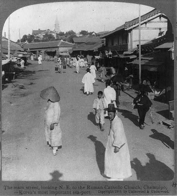 The main street, looking N.E. to the Roman Catholic Church, Chemulpo, Korea