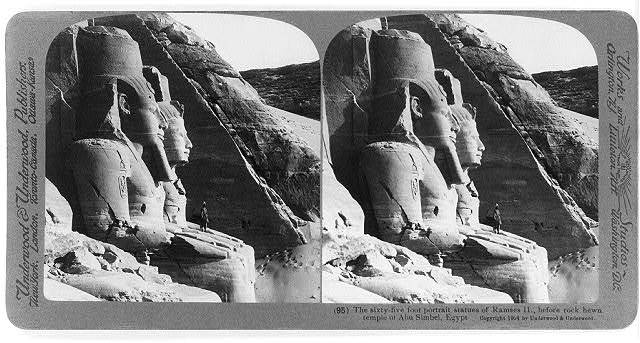 The sixty-five foot portrait statues of Ramses II, before rockhewn temple of Abu Simbel, Egypt