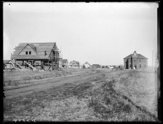 Two-story house under construction, Overton, Nebraska.