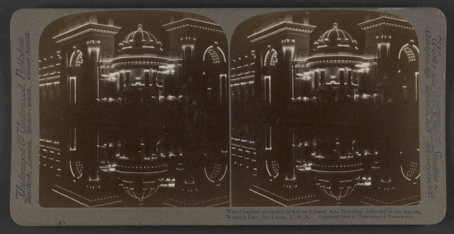 Wierd beauty of electric lights on Liberal Arts Building, reflected in the lagoon, World's Fair,  St. Louis,  U.S.A.