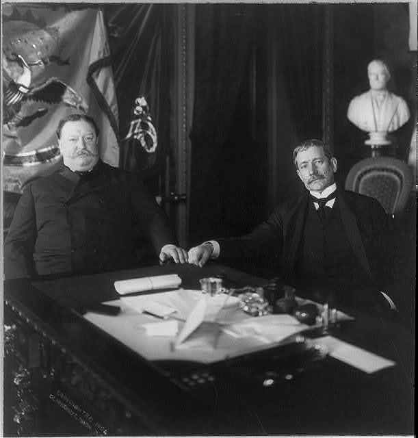 William Howard Taft and Elihu Root seated at desk
