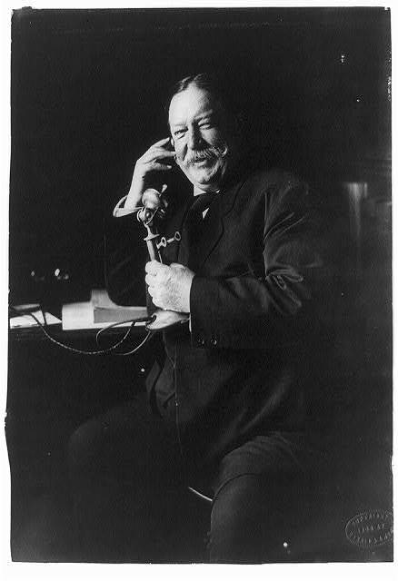 [William Howard Taft, three-quarter-length portrait, seated facing left, on telephone] / copyright by Harris & Ewing.