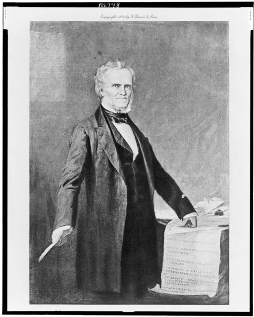 [William Lyon Mackenzie, three-quarter length portrait, standing, facing slightly right, with left hand on papers]