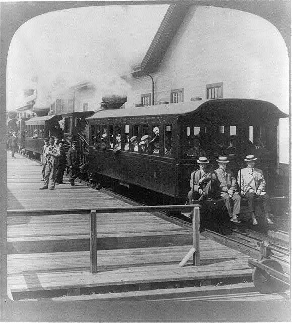 All aboard for the clouds! trains at Mt. Washington's base ready for trip to summit (6290 ft.), N.H.