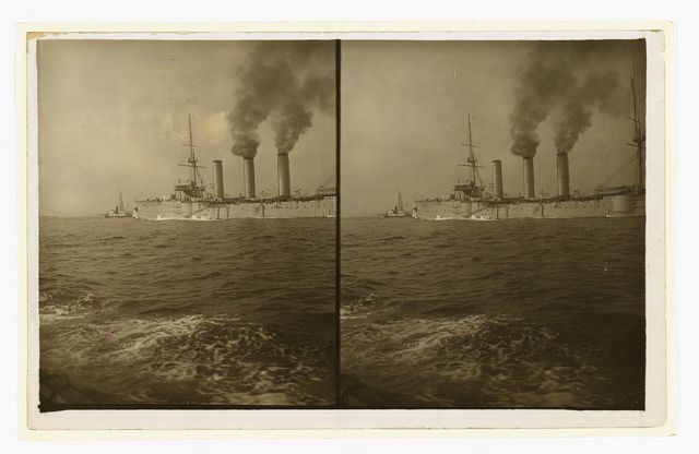 [An American cruiser being guided by a tugboat past the Statue of Liberty, as it arrives in New York, probably at the time of the Portsmouth Peace Conference]