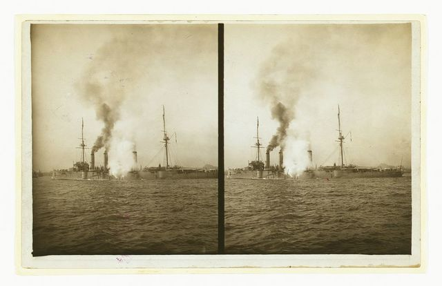 [An American cruiser firing its guns in salute as it arrives in New York, probably at the time of the Portsmouth Peace Conference]