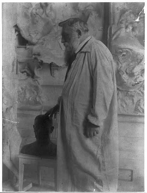 [Auguste Rodin, three-quarter length portrait]
