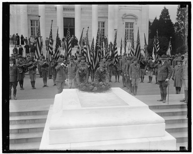 Boy Scouts honor America's Unknown Soldier in observing Armistice Day. Among the first to observe Armistice Day in Washington were the Boy Scouts of America, who journeyed to Arlington National Cemetery bright and early where they paid a colorful tribute to America's Unknown Soldier. Richard Buddeke and Wagner Lawder, Eagle Scouts, are placing[?] the wreath, while Dick Babcock is blowing taps