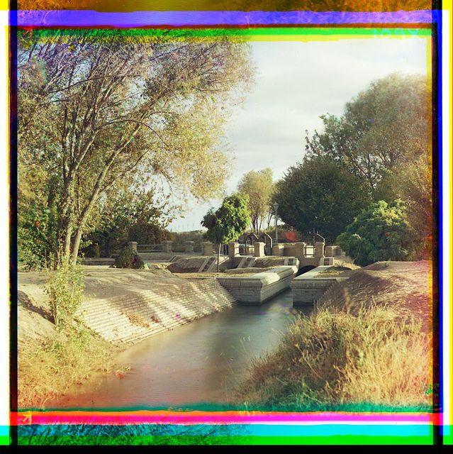 [Brick aqueduct(?) in park-like setting]