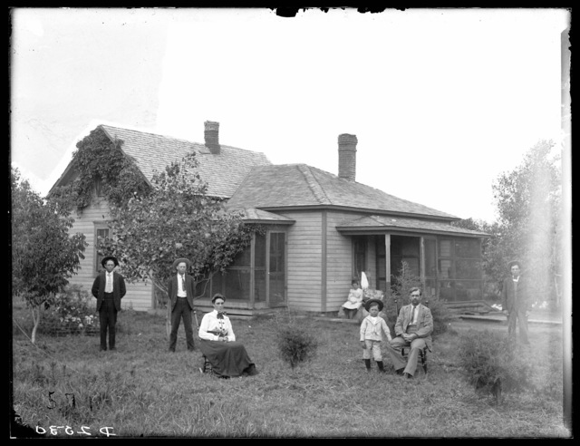 C.A. Hagstrom and family in front of their home near Overton, Dawson County, Nebraska.