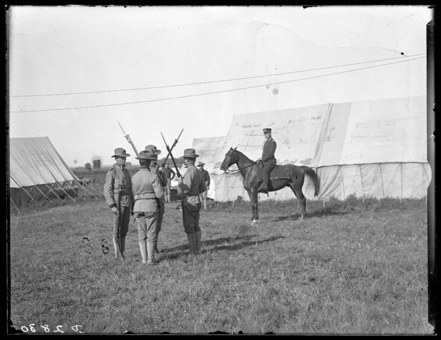 Captain Davis and three guards at the Nebraska National Guard Camp, Kearney, Nebraska.