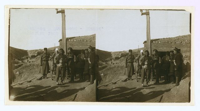 [Carrying wounded Russian in a jinriksha from the front down to the hospital in Port Arthur]
