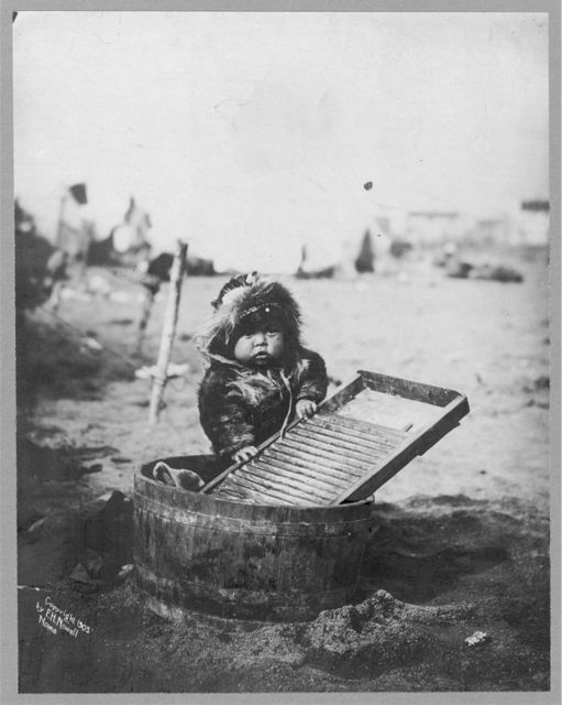 Child at washtub