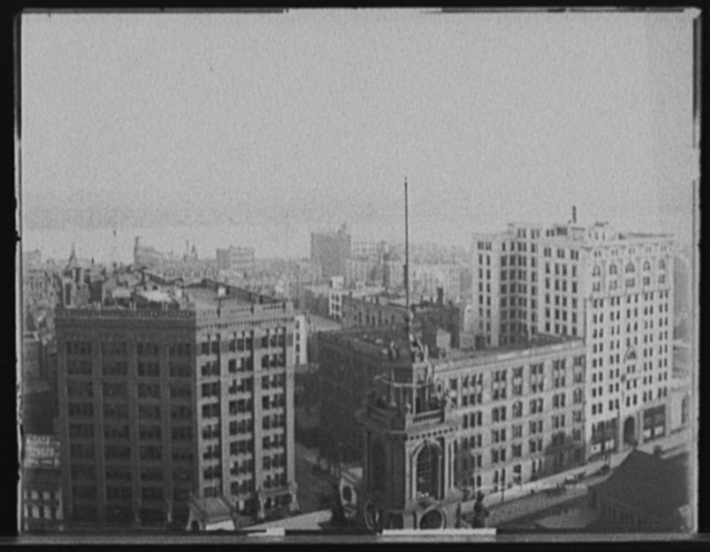 [Church tower, commercial buildings and waterfront, probably Detroit]