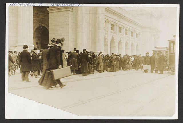 [Crowd standing outside possibly Union Station waiting to board streetcars]