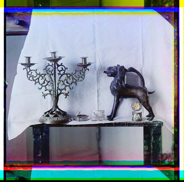 [Decorative items on display including a candleabra, boxes, and a carved animal sculpture]