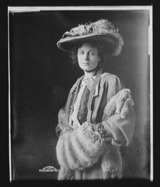[Eleanor Robson Belmont, three-quarter length portrait in hat and fur muff]