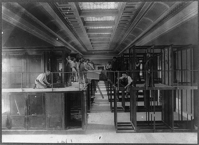 [Erecting mahogany display cases in the south curtain of the new Library of Congress building]