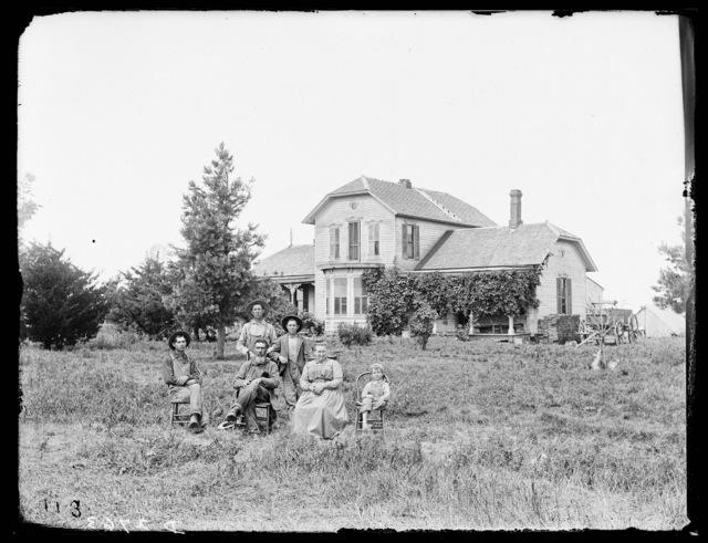 Family in front of M.J. Spry residence, Kearney, Nebraska.