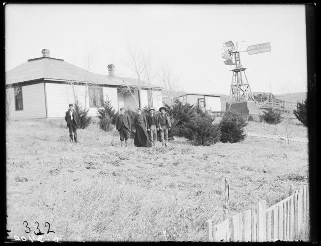 Family in front of the W.T. Woody farmhouse, Lomax, Nebraska