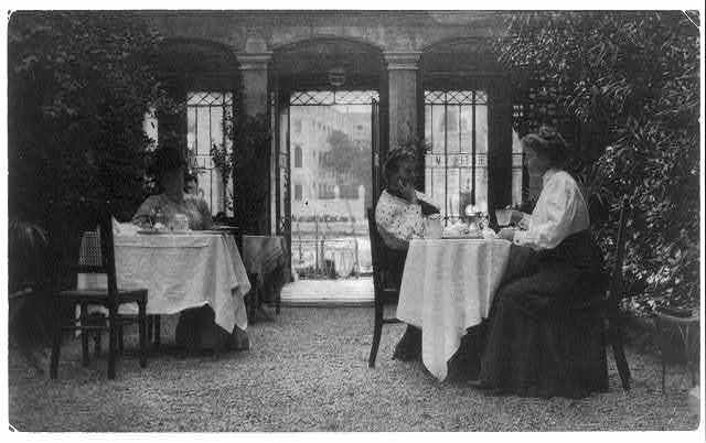FBJ and Mrs. Gertrude Käsebier, famous photographer, on patio of a Venetian hotel
