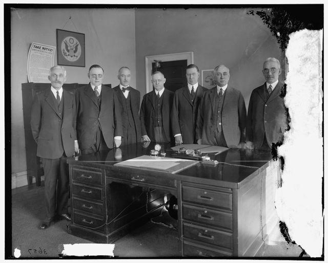 Federal Reserve Board, left to right: Sec'y Mellon; W.P.G. Harding; Vice Gov. Edmund Platt; Charles S. Hamlin; Adolph Miller; Comptroller D.R. Crissinger, and J.R. Mitchell