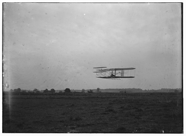 [Flight 23: front view of the machine in flight to the right, Orville at the controls, making two complete circles of the field at Huffman Prairie in 2 minutes and 45 seconds; Dayton, Ohio]