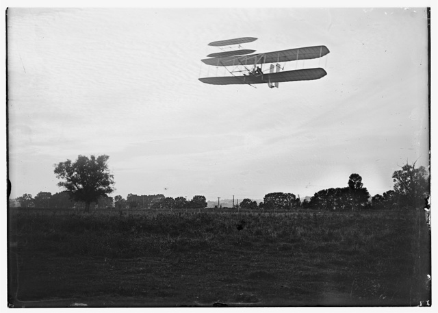[Front view of flight 41, Orville flying to the left at a height of about 60 feet; Huffman Prairie, Dayton, Ohio]