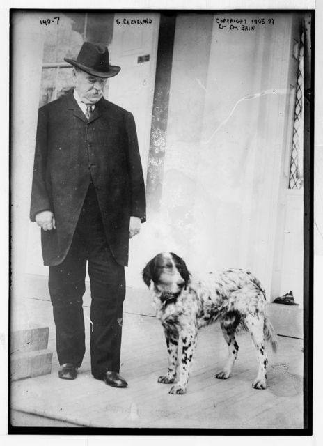 G. Cleveland, standing with dog