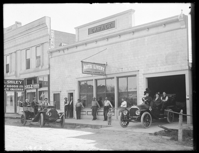 Group in front of the O.W. Parr and X.D. Johnson Auto Livery, Merna, Nebraska.