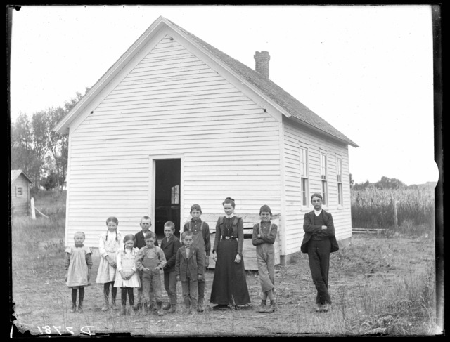 Group of students and teacher in front of a school building in Cozad, Nebraska