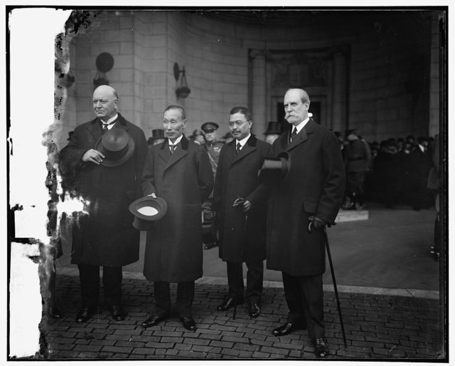 Japanese Delegates to Arms Conference, left to right: Denby, Admiral Kato, Prince Tokugawa, and Sec'y Hughes