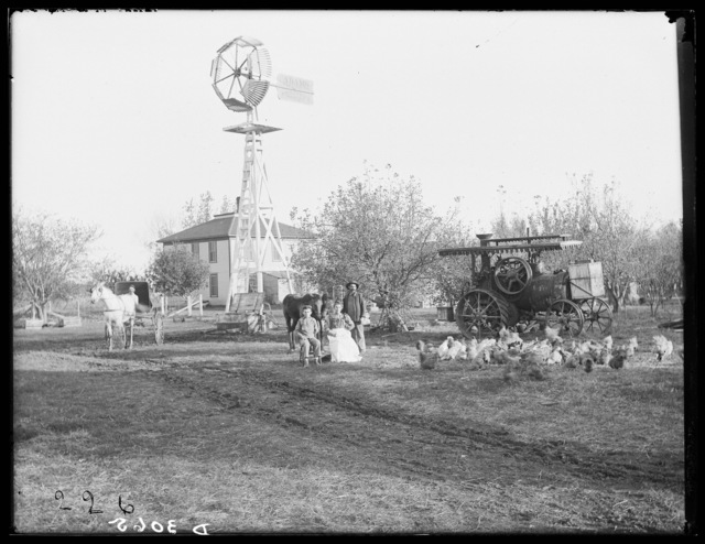 John Nedikorn and family in front of their Buffalo County farmhouse.